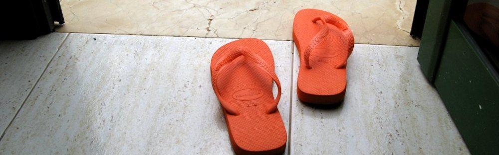 Nicki Hastie's orange flip flops attempting to walk out an open door